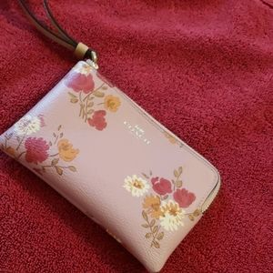 Coach pink flowered wristlet